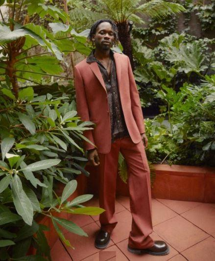 Mr. Eazi replies follower who dragged him over his Paul Smith designer suit